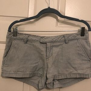 Volcom pin stripped shorts.